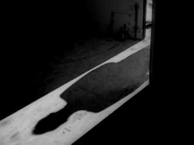 man and open door